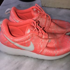Pink and white nike roshes